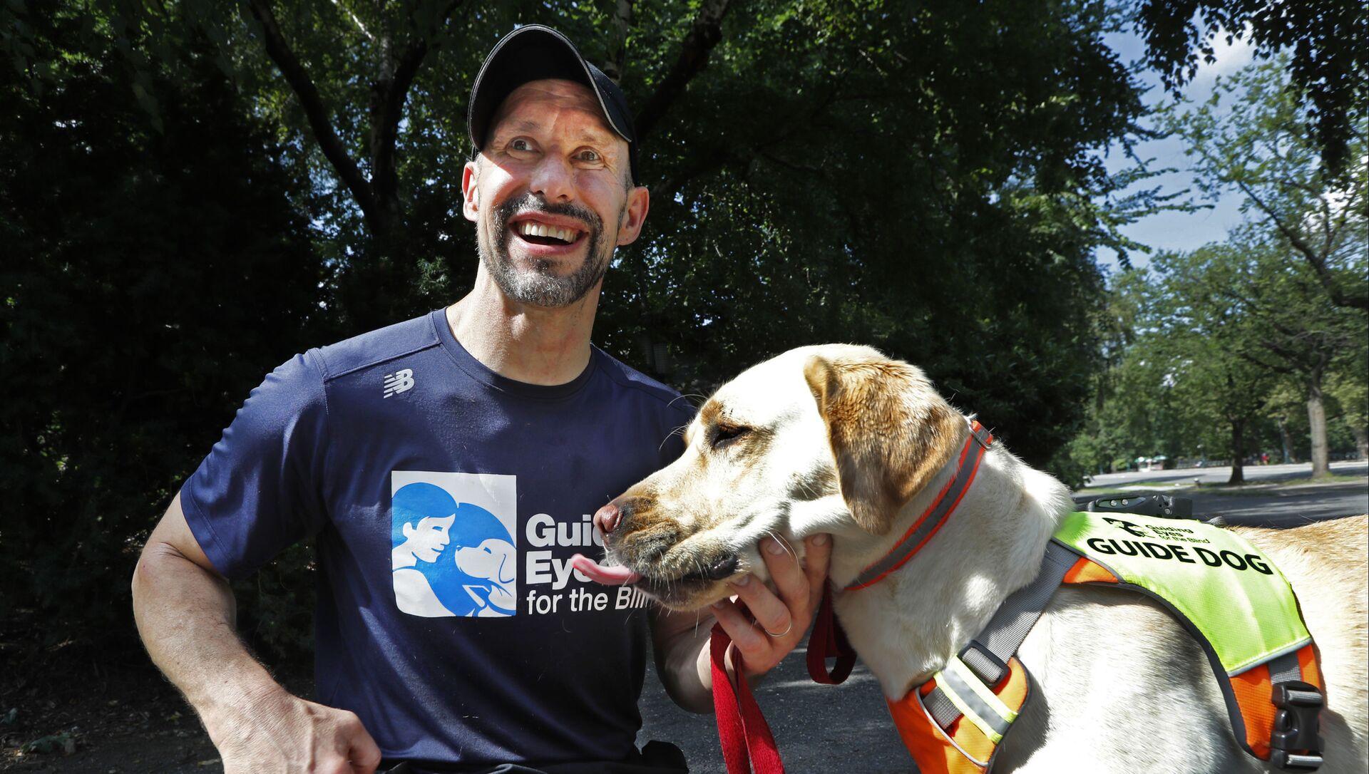 Κλίνγκερ: Ο πρώτος πιστοποιημένος σκύλος οδηγός τρεξίματος - Sputnik Ελλάδα, 1920, 19.02.2021