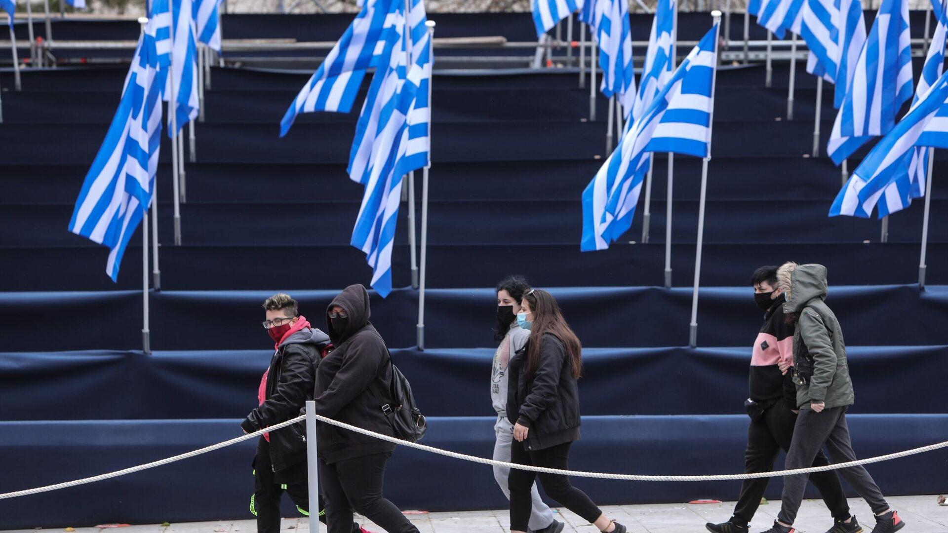 Ελληνικές σημαίες στο Σύνταγμα για την παρέλαση της 25ης Μαρτίου - Sputnik Ελλάδα, 1920, 14.10.2021
