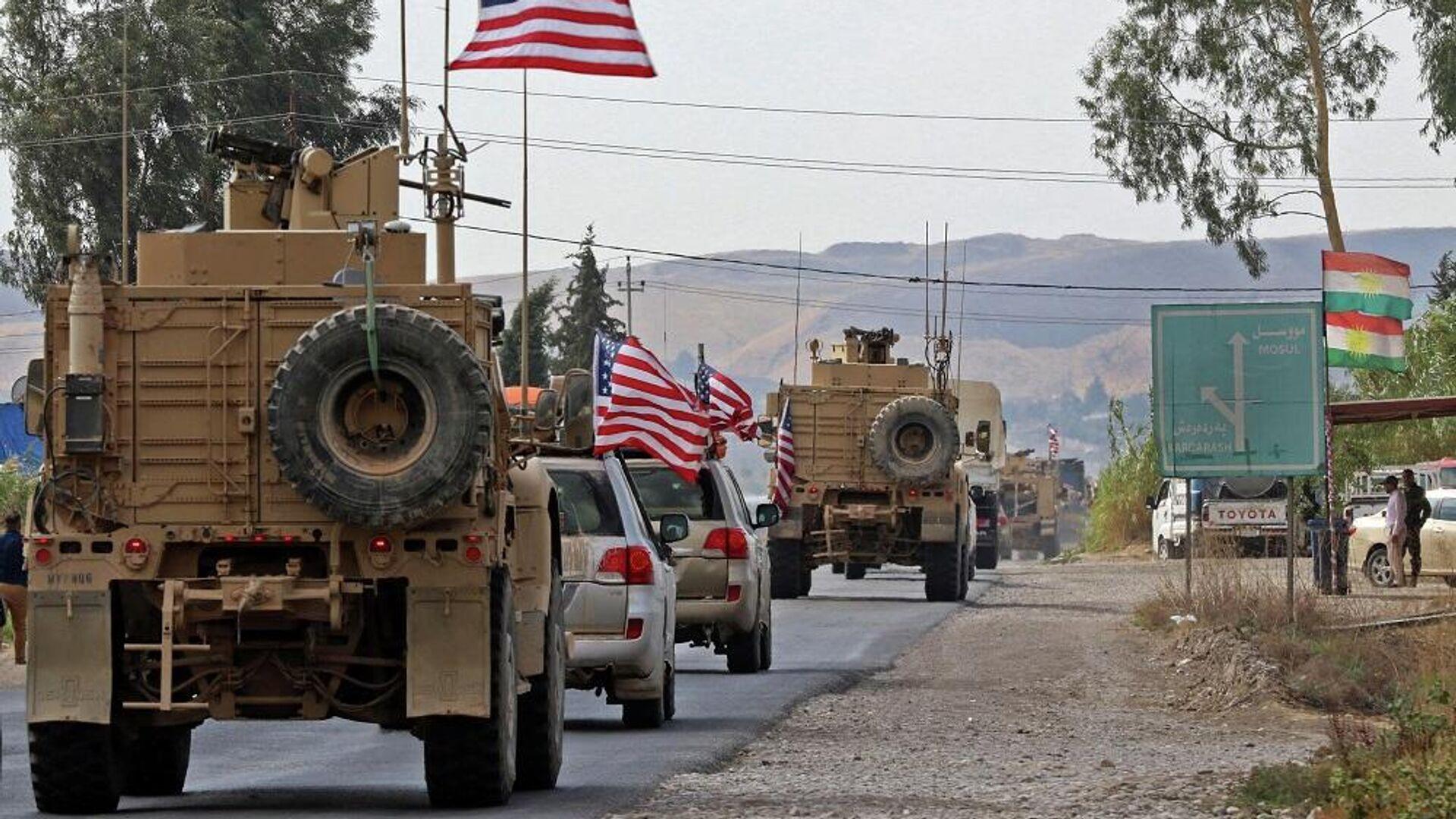 Κομβόι αμερικανικών στρατιωτικών οχημάτων φτάνει στο Ιράκ αποχωρώντας από τη βόρεια Συρία - Sputnik Ελλάδα, 1920, 06.09.2021