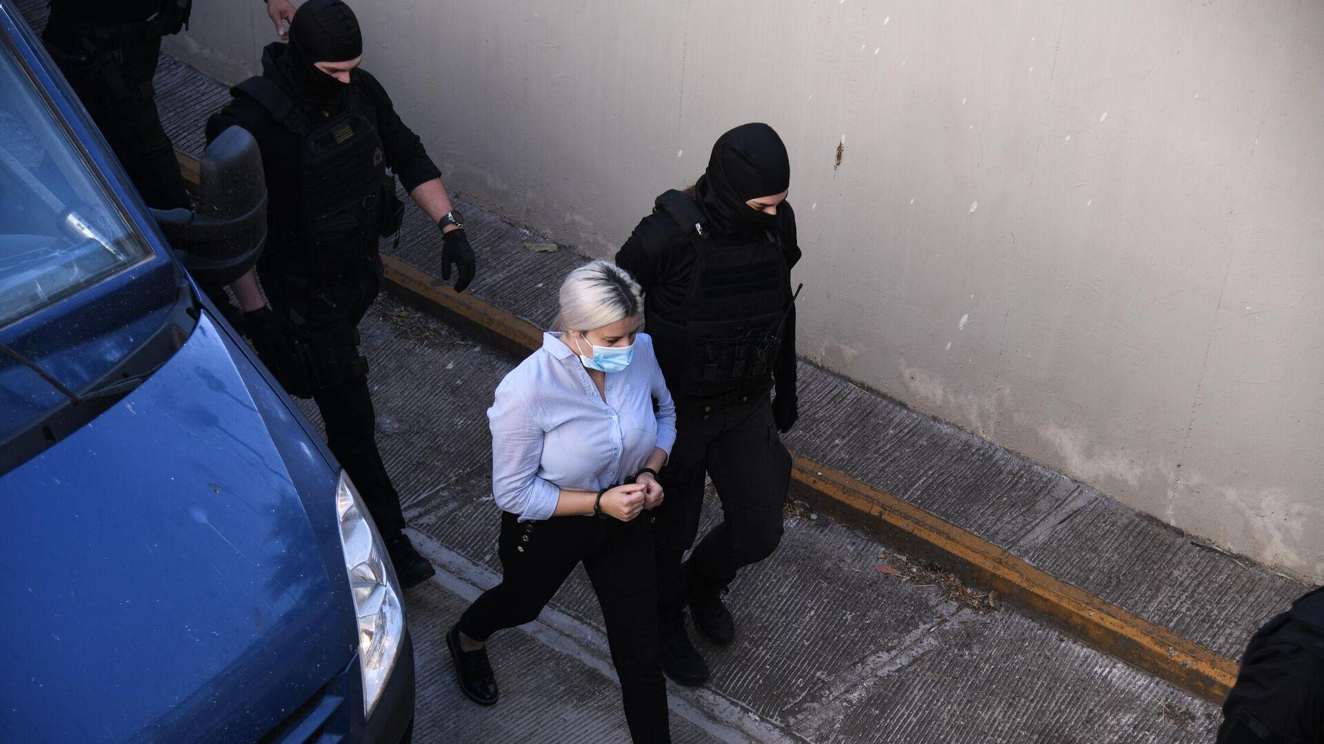 Άφιξη στο Δικαστήριο της κατηγορούμενης για την επίθεση με βιτριόλι.  - Sputnik Ελλάδα, 1920, 09.10.2021