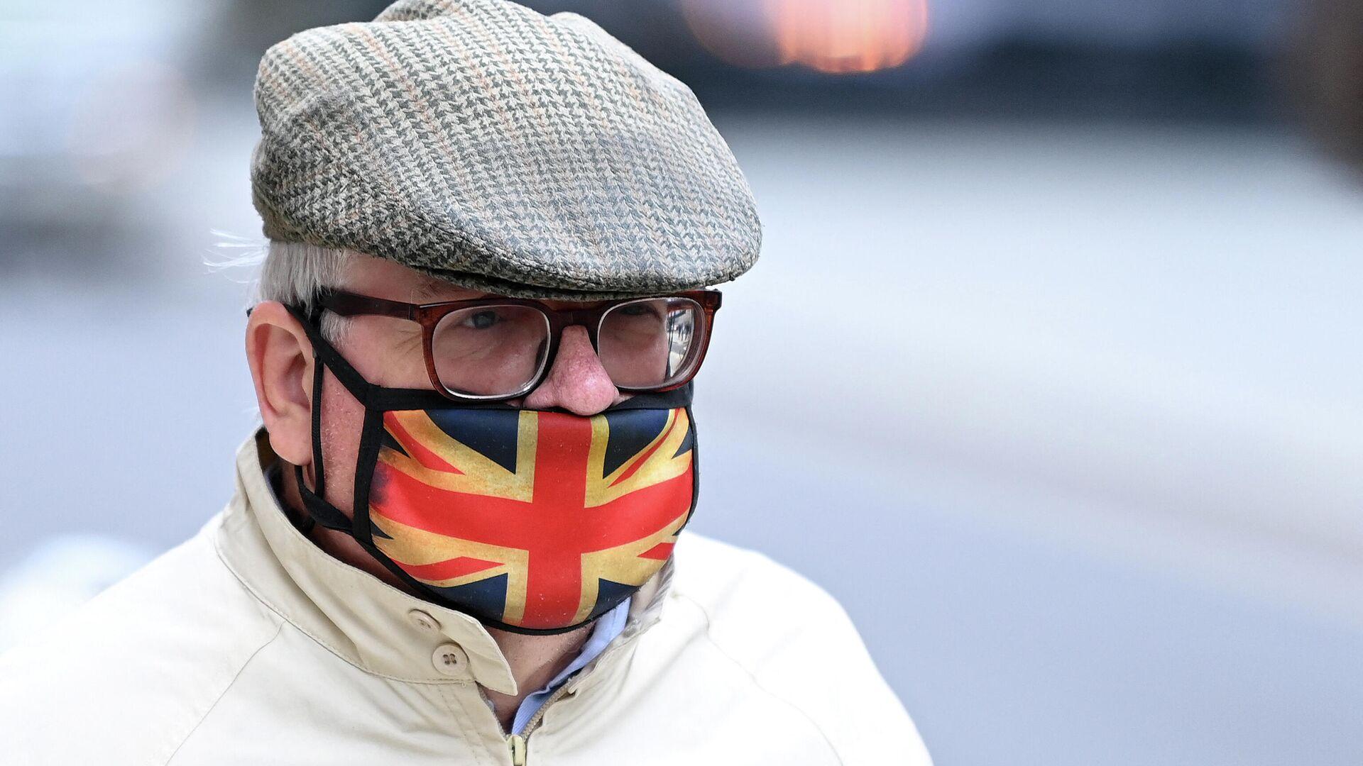Βρετανός με μάσκα στο Λονδίνο - Sputnik Ελλάδα, 1920, 12.10.2021