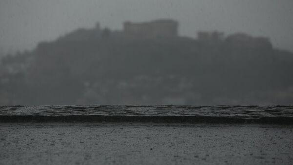Σκόνη, βροχή και υγρασία καλύπτουν την ατμόσφαιρα της Αττικής, στην Αθήνα, στις 6 Φεβρουαρίου, 2019 - Sputnik Ελλάδα