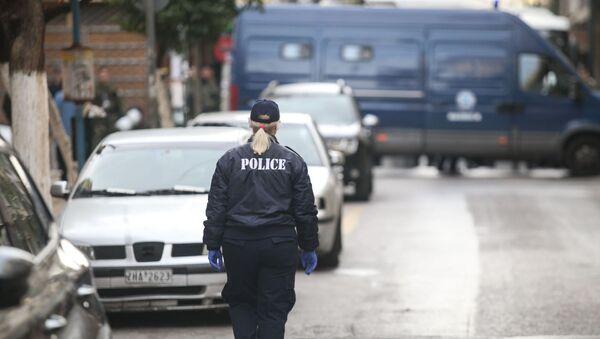 Στιγμιότυπο από αστυνομική επιχείρηση εκκένωσης υπό κατάληψη κτιρίου στα Εξάρχεια. - Sputnik Ελλάδα