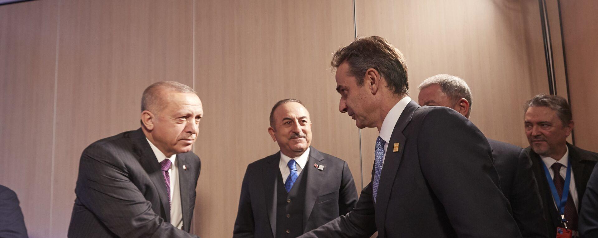 Κυριάκος Μητσοτάκης - Ρετζέπ Ταγίπ Ερντογάν κατά τη συνάντησή τους στη Σύνοδο του ΝΑΤΟ - Sputnik Ελλάδα, 1920, 20.08.2021