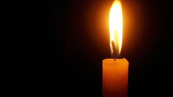 Ένα αναμμένο κερί (φωτ. αρχείου) - Sputnik Ελλάδα