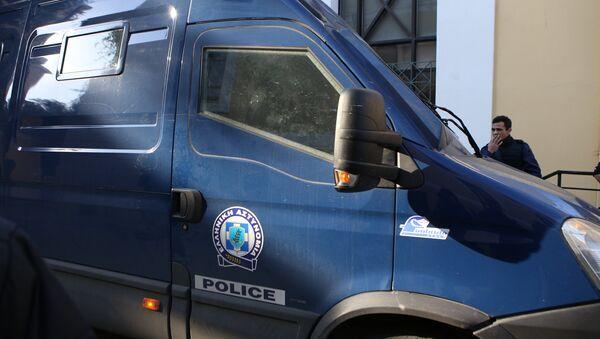 Αστυνομιικό όχημα στα δικαστήρια της Ευελπίδων - Sputnik Ελλάδα