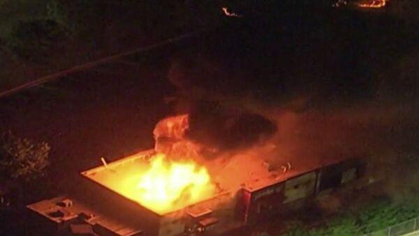 Πυρκαγιά σε εστιατόριο στην Ατλάντα μετά τον θάνατο Αφροαμερικανού από αστυνομικά πυρά, 13 Ιουνίου 2020 - Sputnik Ελλάδα