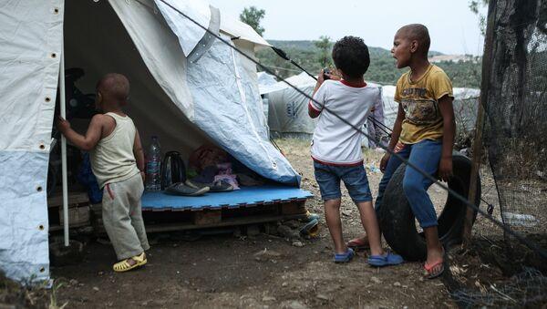 Στιγμιότυπα από το Κέντρο Φιλοξενίας Προσφύγων της Μόριας. - Sputnik Ελλάδα